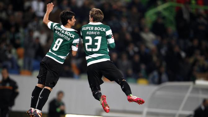 Sporting's Adrien Silva celebrates his goal with his teammate Andre Martins during their Portuguese Premier League soccer match against Belenenses in Lisbon