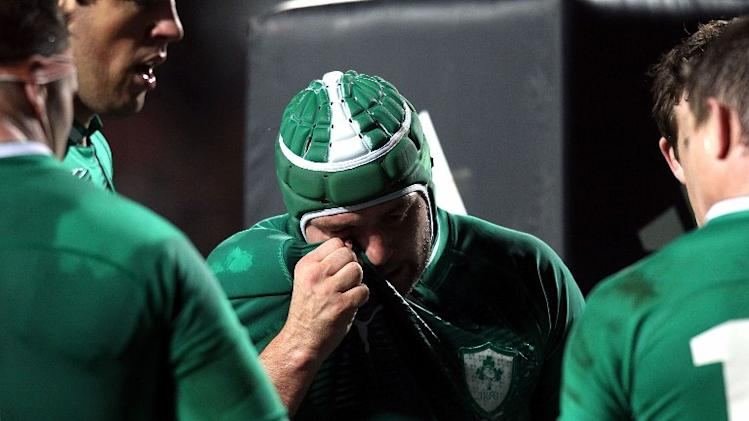 Cian Healy of Ireland (C) gestures after New Zealand score a try during their third and final rugby union Test match against New Zealand at Waikato Stadium in Hamilton on June 23, 2012. New Zealand beat Ireland 60-0 for a clean-sweep of the series.  AFP PHOTO / MARTY MELVILLE