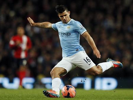 Manchester City's Aguero kicks the ball during their FA Cup third round soccer match against Blackburn Rovers at the Etihad stadium in Manchester