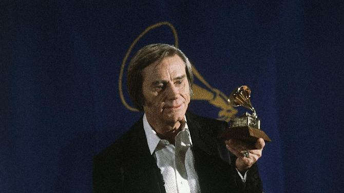 "FILE - In this Feb. 25, 1981 file photo, Country singer George Jones poses with the Grammy he won for best male country vocal performance of ""He Stopped Loving Her Today"", at the awards at Radio City Music Hall in New York.  Jones, the peerless, hard-living country singer who recorded dozens of hits about good times and regrets and peaked with the heartbreaking classic ""He Stopped Loving Her Today,"" has died. He was 81. Jones died Friday, April 26, 2013 at Vanderbilt University Medical Center in Nashville after being hospitalized with fever and irregular blood pressure, according to his publicist Kirt Webster. (AP Photo, file)"
