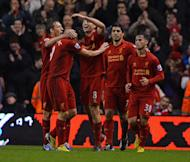Liverpool's midfielder Steven Gerrard (C) celebrates with Stewart Downing (2nd L) and teammates after scoring their second goal during the English Premier League football match against Fulham at Anfield in Liverpool, north-west England on December 22, 2012. Downing finally ended his Premier League goal drought as the Reds swept to a 4-0 victory over Fulham at Anfield