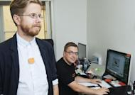 Co-founder and CEO of Swedish Memoto, Martin Kaellstroem (R), looks to one of the company's workers wearing the life-logging Memoto camera in Stockholm on August 29, 2013. Lifelogging does raise some privacy questions, says Steven Savage, a researcher at the Swedish Defence Research Agency, noting that the private sphere is relative: what is not offensive to one person might be to another