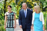 US Vice President Joe Biden, pictured with his daughter Ashley Biden (L) and wife Jill Biden during a visit to the National Orchid Garden in Singapore on July 26, 2013. Biden Friday called on Asian nations to reduce tensions in disputed waters across the region as Washington redoubles efforts to confront China's growing maritime presence there