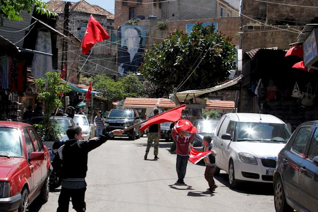 Children play while waving Turkish flags in Tripoli, North Lebanon
