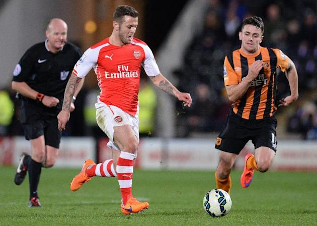 Arsenal's midfielder Jack Wilshere (C) vies for the ball with Hull City's midfielder Robbie Brady during the English Premier League football match on May 4, 2015