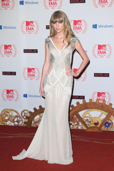"""Taylor Swift: If the point of this figure-flattering gown is to make Taylor's ex-boyfriend Connor Kennedy jealous, then she has probably succeeded. The """"Red"""" singer looks stunning in the Old Hollywood style frock with diamond panels. Taylor rocks her fringe with confidence! (Photo by Mike Marsland/WireImage)"""