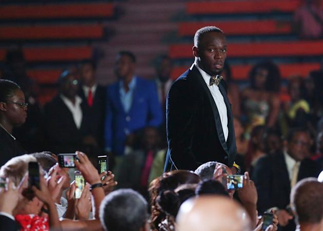 Jamaican Olympic gold medallist Usain Bolt arrives for an event in Kingston