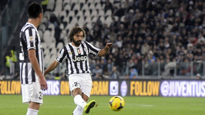 Juventus' Pirlo shoots to score during Italian Serie A match against Napoli in Turin