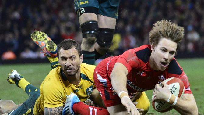 Australia's Quade Cooper (L) tackles Wales' Liam Williams on the try line to prevent Williams from scoring during their international rugby union match in Cardiff