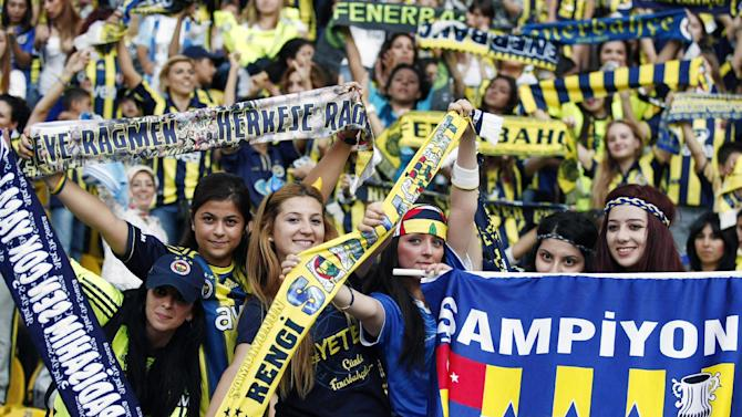 More than 41,000 women and children filled Sukru Saracoglu Stadium to watch Fenerbahce play against Manisapor in Turkish League soccer match in Istanbul, Turkey, Tuesday, Sept. 20. 2011. Turkey came up with a radical solution for tackling crowd violence at football matches _ ban the men and let only women and children in. Under new rules approved by Turkey's football association, only women and children under the age of 12 will be admitted to watch games _ for free _ involving teams which have been sanctioned for unruly behavior by their fans. Fenerbahce was ordered to play two home matches without any spectators after its fans invaded the pitch during a friendly against Ukrainian champion Shakhtar Donetsk.(AP Photo/TURKPIX)