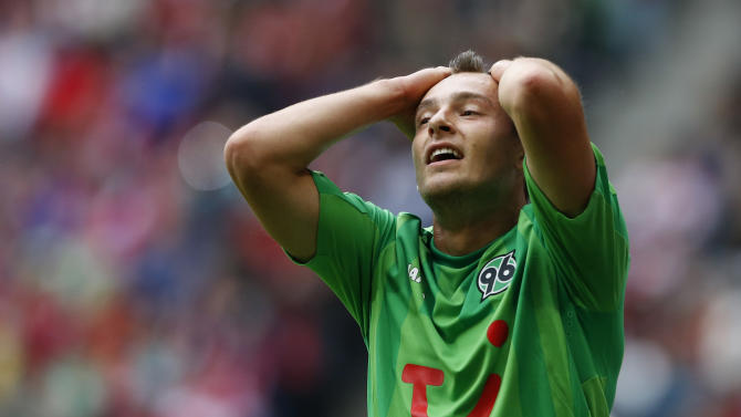 Hannover's Artur Sobiech of Poland reacts during the German first division Bundesliga soccer match between FC Bayern Munich and Hannover 96, in Munich, southern Germany, Saturday, Sept. 14, 2013