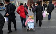 A baby is pulled in its pushchair on a street in Beijing. The health-giving qualities of placenta are currently creating a buzz in Western countries, where some believe it can help ward off postnatal depression, improve breast milk supply and boost energy levels