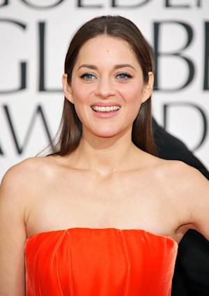 """FILE - This Jan. 13, 2013 file photo shows actress Marion Cotillard at the 70th Annual Golden Globe Awards in Beverly Hills, Calif. Cotillard has been named the 2013 Harvard University Hasty Pudding Theatricals Woman of the Year. The French actress, who won the 2007 best actress Oscar for her role in """"La Vie En Rose,"""" will be honored with a parade and roast, and given her ceremonial pudding pot, at Harvard on Jan. 31. (Photo by John Shearer/Invision/AP, file)"""