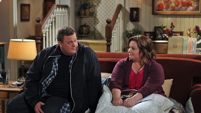 "In this image released by CBS, Billy Gardell, left, and Melissa McCarthy are shown in a scene from the sitcom ""Mike & Molly."" Arizona tribal members say they're shocked by the sitcom after one of the characters on the CBS show joked last week about drunken Indians in Arizona. Navajo Nation spokesman Erny Zah says while alcoholism is easy to judge from the outside, the disease isn't funny. He says it can lead to assaults, break up families and instill fear in children. The Native American Journalists Association says CBS should apologize. (AP Photo/CBS, Michael Ansell)"