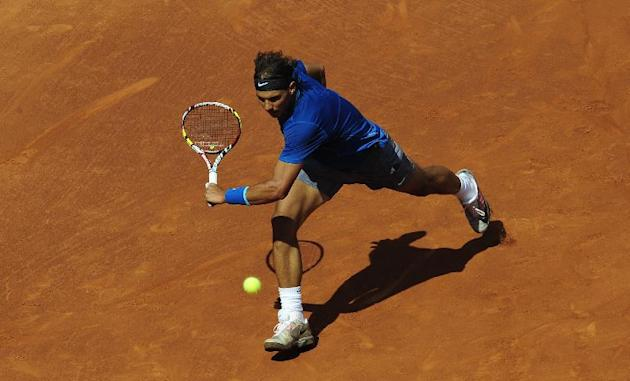 Rafael Nadal returns the ball to Albert Ramos during the Barcelona open tennis in Barcelona, Spain, Wednesday, April 23, 2014