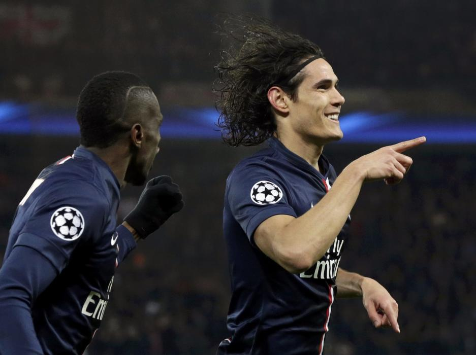 Paris St Germain's Edinson Cavani reacts after scoring a goal with teammate Blaise Matuidil during their Champions League round of 16 first leg...