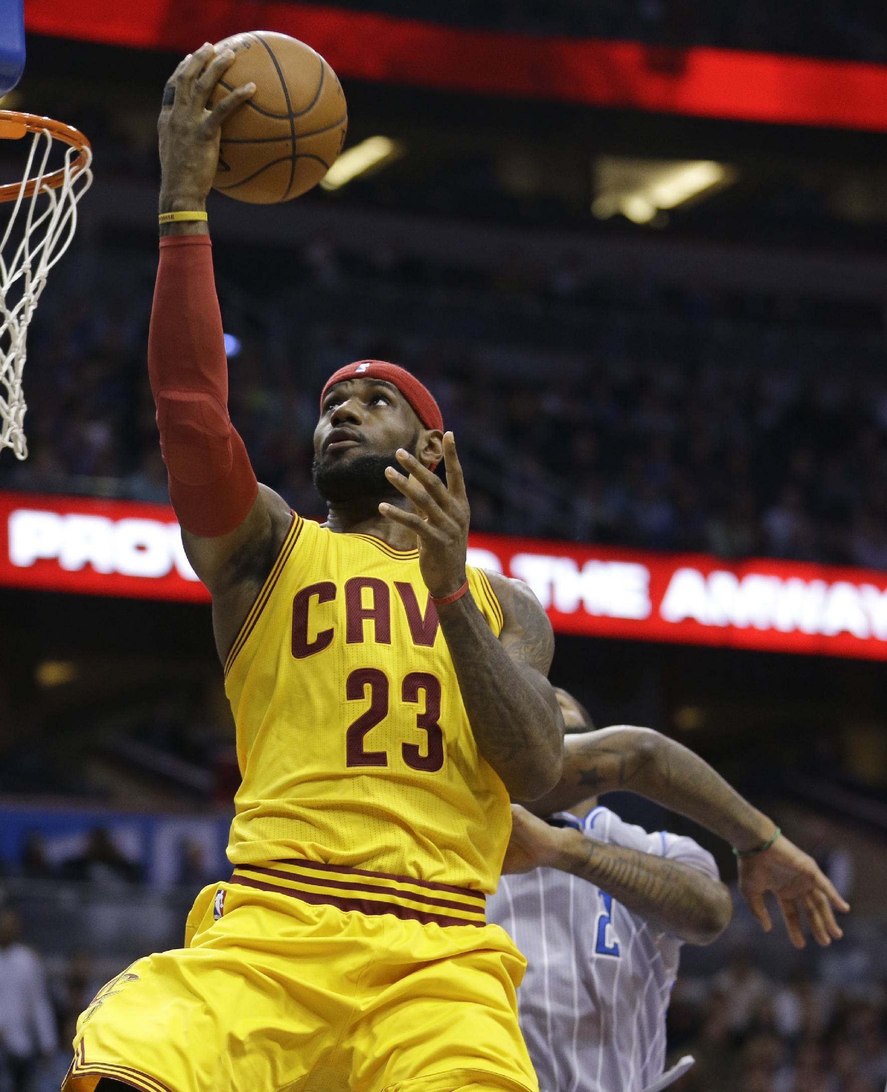 James helps Cavaliers rally past Magic 98-89