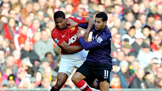 Andre Santos, right, battles for the ball with Antonio Valencia in Saturday's clash at Old Trafford