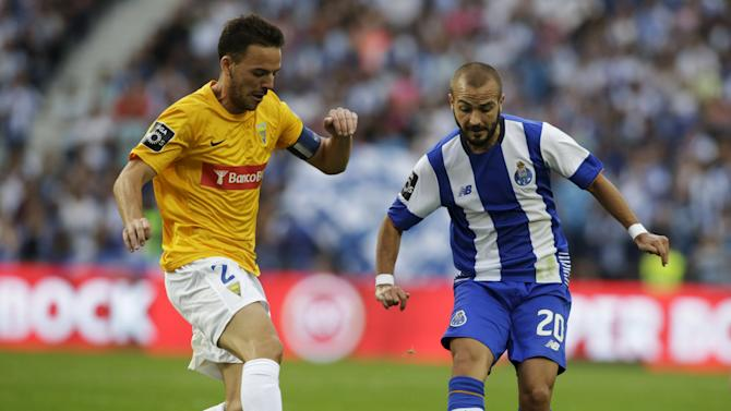 Porto's Andre fights for the ball with Estoril's Tavares during their Portuguese Premier League soccer match at Dragao stadium in Porto