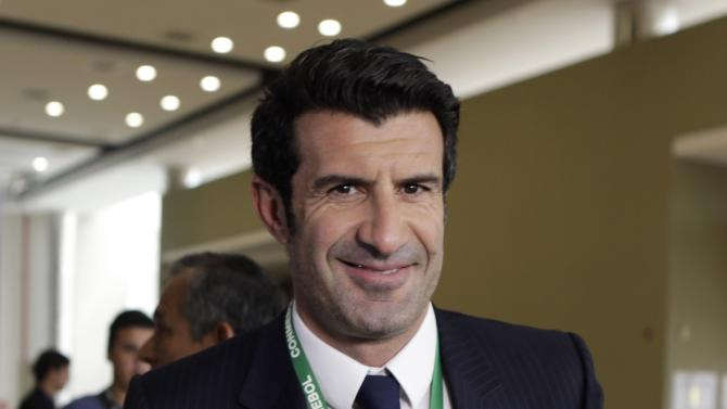 Former soccer player Luis Figo of Portugal arrives for the CONMEBOL ordinary congress in Luque