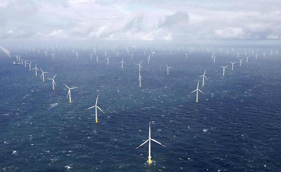 Power-generating windmill turbines are pictured at the 'Amrumbank West' offshore windpark in the northern sea near the island of Amrum