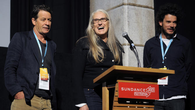 """Jane Campion, center, co-writer and co-director of the Sundance Channel scripted series """"Top of the Lake,"""" addresses the audience alongside co-writer Gerard Lee, left, and co-director Garth Davis at the premiere of the series at the 2013 Sundance Film Festival, Sunday, Jan. 20, 2013, in Park City, Utah. (Photo by Chris Pizzello/Invision/AP)"""
