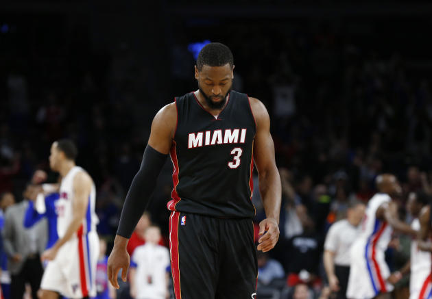 FILE - In this April, 2015 file photo, Miami Heat guard Dwyane Wade walks off the court after missing a last-second shot against the Detroit Pistons in the second half of an NBA basketball game in Aub