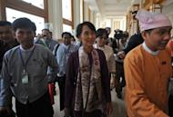 Myanmar opposition leader Aung San Suu Kyi (C) arrives at the lower house of parliament to read her parliamentary oath during a session in Naypyidaw, on May 2. After a triumphant European tour where she was lauded by crowds, stars and heads of state, Suu Kyi returns to the reality of Myanmar's politics this week when she makes her debut as a lawmaker