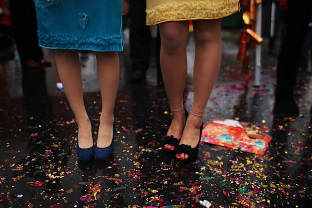 Two Chinese singers stand on glitter during celebrations of the Chinese New Year in Chinatown. (Getty Images)