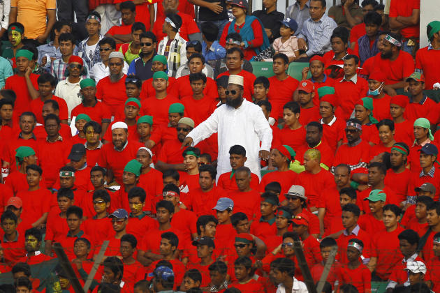 Bangladeshi cricket lovers watch the Asia Cup one-day international cricket tournament match between Afghanistan and Bangladesh in Fatullah, near Dhaka, Bangladesh, Saturday, March. 1, 2014. (AP Photo
