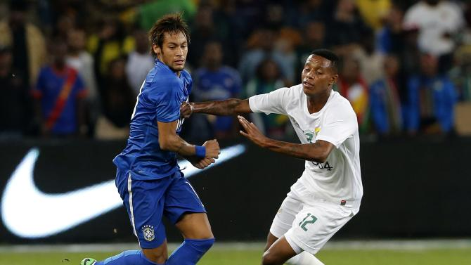 Brazil's Neymar is challenged by South Africa's Bongani Zungu during their international friendly soccer match at the First National Bank (FNB) Stadium, also known as Soccer City, in Johannesburg