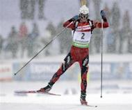 Ole Einar Bjorndalen of Norway competes during the men's 12.5 km pursuit biathlon World Cup event in Ostersund December 5, 2010. REUTERS/Ints Kalnins