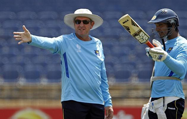 FILE - This is a Saturday, Feb. 19, 2011 file photo of Sri Lanka's coach Trevor Bayliss, left,s he talks with captain Kumar Sangakkara during a practice session at Mahinda Rajapaksa International