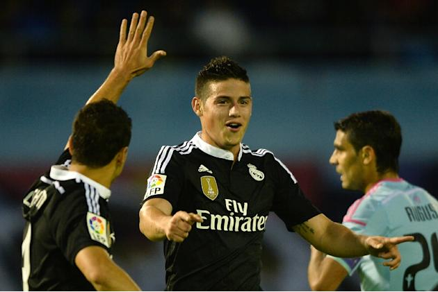 Real Madrid's James Rodriguez (C) celebrates after scoring a goal during their Spanish La Liga match against Celta Vigo, at the Balaidos stadium in Vigo, on April 26, 2015