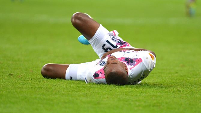 Nicolas Maurice-Belay of Bordeaux is on the ground during the UEFA Europa League Group F  soccer match between Eintracht Frankfurt and Girondins Bordeaux  in Frankfurt, Germany,  Thursday Sept. 19, 2013