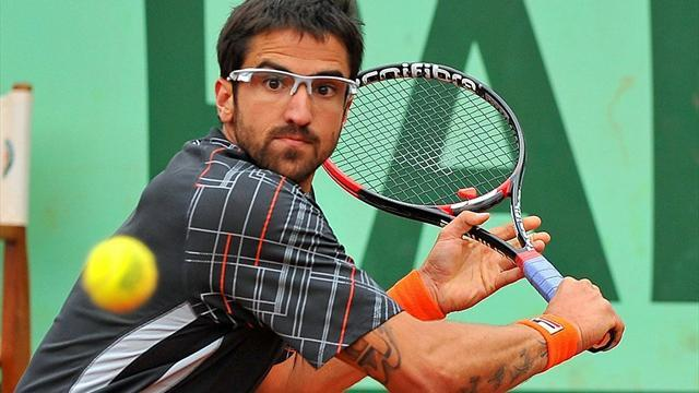 Tennis - Injured Tipsarevic withdraws after three games