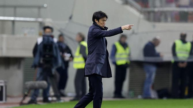 South Korea's coach Hong Myungbo gives instructions to his players during a friendly soccer match at Georgios Karaiskakis stadium against Greece in Piraeus port, near Athens, Wednesday, March 5, 2014