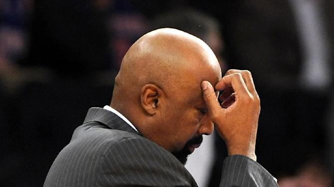 New York Knicks' head coach Mike Woodson reacts to his team as they fall behind during the first half of an NBA basketball game against the Boston Celtics on Sunday, Dec. 8, 2013, in New York