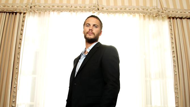 "In this Friday, June 15, 2012 photo, actor, Taylor Kitsch, who appears in Oliver Stone's new film ""Savages,"" poses for a portrait in Beverly Hills, Calif. Kitsch plays a California marijuana dealer in the movie, along with actor, Aaron Johnson, battling a vicious Mexican cartel that aims to take over their business growing primo weed. (Photo by Matt Sayles/Invision/AP)"