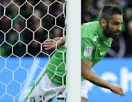 Loic Perrin celebrates after scoring for Saint-Etienne during a French league match against Lorient on February 12, 2017