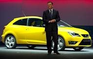 Seat President and CEO James Muir displays a Seat Ibiza Cupra car during a Volkswagen Group presentation event in Beijing. The German automaker Volkswagen will build a new plant in Xinjiang, a province in China's undeveloped far west, a company official said on Sunday