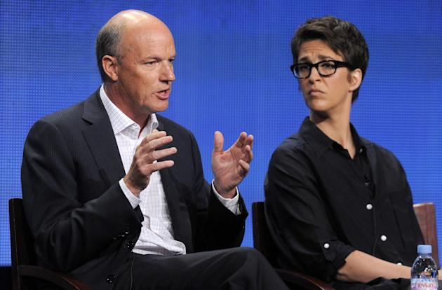 """FILE - In this Aug. 2, 2011 file photo, Phil Griffin, left, president of MSNBC, answers a question as Rachel Maddow, host of """"The Rachel Maddow Show,"""" looks on at the NBC Universal summer pr"""