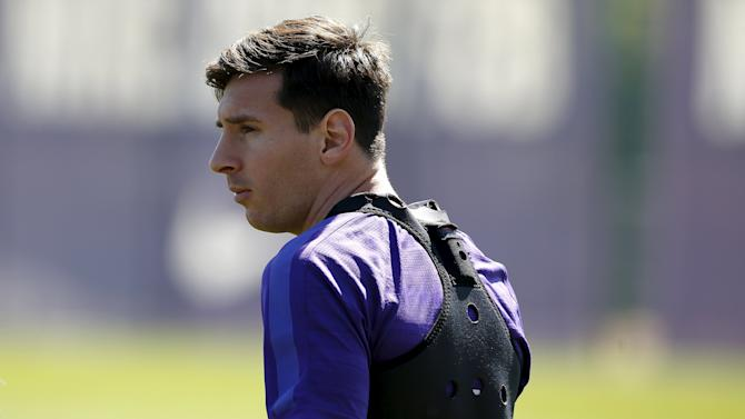 Barcelona's Lionel Messi looks on before a training session at the Barcelona training grounds Ciutat Esportiva Joan Gamper in Sant Joan Despi near Barcelona