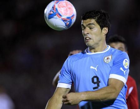 Suarez of Uruguay heads the ball against Jordan during the 2014 World Cup qualifying playoff second leg soccer match in Montevideo