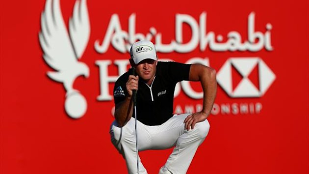 Jamie Donaldson of Wales lines up a putt during the final round of the Abu Dhabi Golf Championship at the Abu Dhabi Golf Club (AFP)