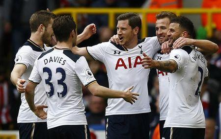 Tottenham's Harry Kane celebrates scoring their third goal and completing his hat trick with team mates