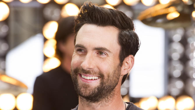 "FILE - In this June 14, 2013 file photo, Maroon 5 lead singer Adam Levine appears on NBC's ""Today"" show in New York. Levine's representative confirmed Tuesday, July 16, 2013, that the Maroon 5 singer is engaged to model Behati Prinsloo. The couple started dating last year. The 34-year-old singer proposed to 24-year-old Prinsloo in Los Angeles this weekend. Levine is also a judge on the NBC singing series ""The Voice."" (Photo by Charles Sykes/Invision/AP, File)"
