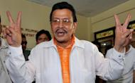 "Former Philippine president Joseph Estrada flashes the victory sign after casting his ballot at a polling station in Manila, on May 10, 2010. In typically colourful fashion, Estrada has launched his campaign for mayor of Manila in what he described as his ""last hurrah"" in politics"
