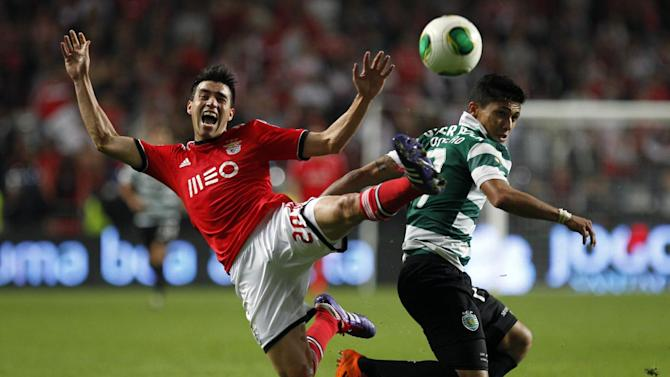 Sporting's Freddy Montero, right, from Colombia tussles for the ball with Benfica's Nico Gaitan from Argentina during a Portugal Cup soccer match between Benfica and Sporting at Benfica's Luz stadium in Lisbon, Saturday, Nov. 9, 2013