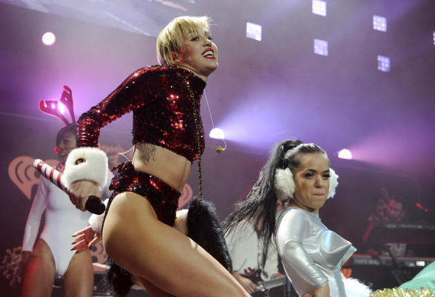FILE - This Dec. 6, 2013 file photo shows Miley Cyrus performing during the KIIS-FM Jingle Ball concert at Staples Center in Los Angeles. MTV has declared that Miley Cyrus is the best artist of the ye